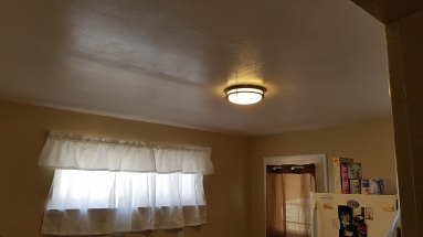 Jackie's husband put up a new light fixture.